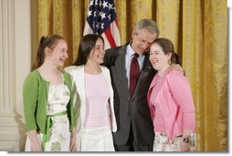 President George W. Bush congratulates ninth graders from Hawken School of Geauga County, Ohio, on receiving the President's Environmental Youth Award in the East Room of the White House April 21, 2005. Members include, from left to right, Karoline Evin McMullen, 14, Angela Primbas, 14, and Amanda Weatherhead, 15.  White House photo by Paul Morse