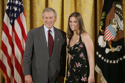 President George W. Bush congratulates Heather Renee Dornan, 18, of Del City High School Water Watch Program Student Volunteers of Del City, Okla., on receiving the President's Environmental Youth Award in the East Room of the White House April 21, 2005. White House photo by Paul Morse