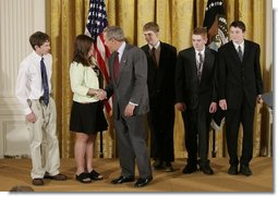 President George W. Bush congratulates students of South Cache 8th and 9th Grade Center in Hyrum, Utah, on receiving the President's Environmental Youth Award in the East Room of the White House April 21, 2005. Members include, from left to right, Parker Hellstern, 14, Tana Hellstern, 16, Aaron Lusk, 15, Bryan Miller, 14, and Jason Newhall, 14. White House photo by Paul Morse