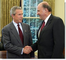 President George W. Bush offers congratulations to John Negroponte, Thursday, April 21, 2005, in the Oval Office after Mr. Negroponte was sworn in as the Director of National Intelligence.  White House photo by Eric Draper