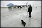 Presidential Valet Master Chief Sam Sutton escorts Barney to Air Force One prior to the President's arrival at Andrews Air Force Base, Friday, April 22, 2005. The President will spend the weekend at his Texas ranch in Crawford after a stop in Tennessee. White House photo by Eric Draper
