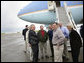 President George W. Bush shares a laugh with his congressional delegation Friday, April 22, 2005, after landing at McGhee Tyson Air National Guard Base in Knoxville. From left are Rep. John Duncan, Jr. (obstructed); Senator Lamar Alexander; Rep. Zach Wamp; Senator Bill Frist; Rep. William Jenkins; EPA Administrator Steve Johnson, and Interior Secretary Gale Norton. White House photo by Eric Draper