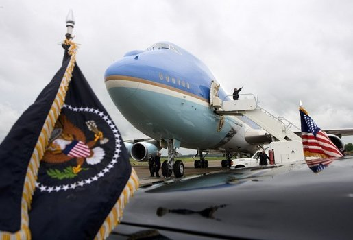 President George W. Bush waves goodbye while boarding Air Force One before departing McGhee Tyson Air National Guard Base in Knoxville en route to his ranch in Crawford, Texas, Friday, April 22, 2005. White House photo by Eric Draper