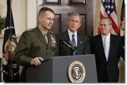 "Gen. Peter Pace addresses the media as President George W. Bush and Secretary of Defense Donald Rumsfeld look on Friday, April 22, 2005. The President announced his nomination of Gen. Pace to be Chairman of the Joint Chiefs of Staff, saying, ""When confirmed by the Senate, General Pete Pace will be the first Marine in history to hold this vital position. He knows the job well."" White House photo by Paul Morse"