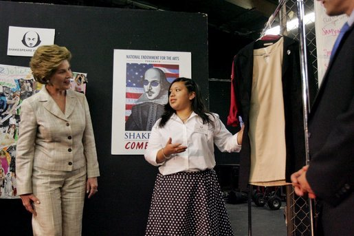 "Laura Bush looks at costumes designed by members of the Will Power to Youth program before watching a performance of ""Romeo and Juliet"" at the Shakespeare Festival/LA's theater in Los Angeles April 26, 2005. Students in the program write their own versions of Shakespeare's plays, create the music, costumes and construct the sets for each production. White House photo by Krisanne Johnson"