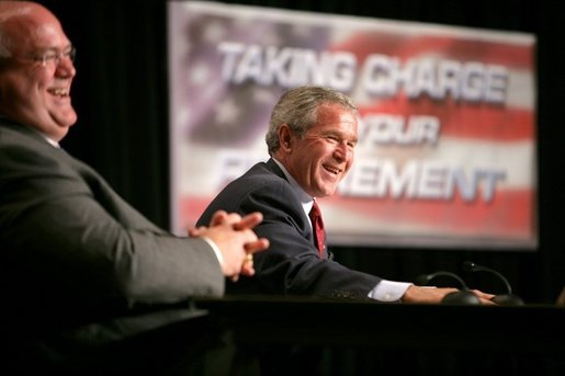 President George W. Bush shares a light moment with Jim Yarbrough, left, County Judge of Galveston County, during a roundtable discussion on Strengthening Social Security at the University of Texas Medical Branch in Galveston, Texas, Tuesday, April 26, 2005. White House photo by Eric Draper
