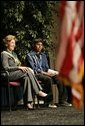 Laura Bush sits with 16-year-old Derwin Tekala, a participant in the Red Road Youth Empowerment Project, before delivering remarks at the Heard Museum in Phoenix, Ariz., April 26, 2005. Mrs. Bush discussed the role of strong family and cultural bonds in helping children resist negative social pressures. White House photo by Krisanne Johnson