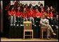 Laura Bush talks with middle school students on stage prior to delivering remarks at Sun Valley Middle School in Sun Valley, Calif., April 27, 2005. White House photo by Krisanne Johnson