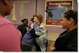 Laura Bush greets students at a reading class while visiting Chipman Middle School in Alameda, Calif., April 28, 2005.  White House photo by Krisanne Johnson