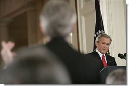 President George W. Bush listens to a reporter's question during a press conference in the East Room Thursday, April 28, 2005.  White House photo by Eric Draper