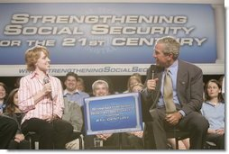 President George W. Bush talks with Colleen Rummel during a conversation on Social Security at the James Lee Community Center, Falls Church, Va., Friday, April 29, 2005.  White House photo by Paul Morse