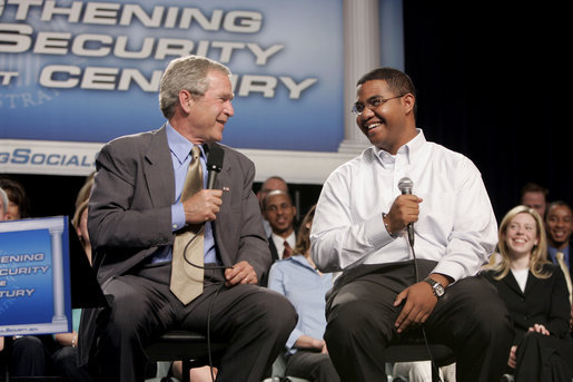 President George W. Bush talks with Yuctan Hodge, 24, during a conversation on Social Security at the James Lee Community Center, Falls Church, Va., Friday, April 29, 2005. White House photo by Paul Morse