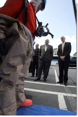 Vice President Dick Cheney and Department of Homeland Security Secretary Michael Chertoff watch a demonstration of an emergency worker donning protective gear during a visit to the Federal Law Enforcement Training Center in Glynco, Georgia, May 2, 2005.  White House photo by David Bohrer