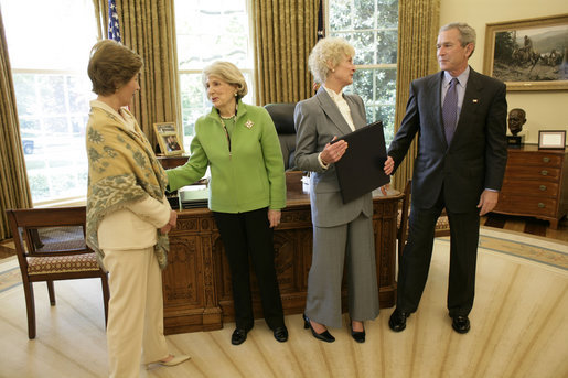 President George W. Bush and Laura Bush meet with Barbara de Marneff and Stephanie Copeland of Edith Wharton Restoration in Massachusetts, in the Oval Office Monday, May 2, 2005. The two women are two of the recipients of the 2005 Preserve America Presidential Award. White House photo by Eric Draper