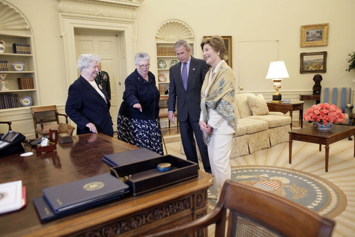 President George W. Bush and Laura Bush discuss some of the history of the Oval Office Agnes Chouteau, left, and Lorraine Stange both of Missouri Monday, May 2, 2005. The two women are recipients of the 2005 Preserve America Presidential Award. White House photo by Eric Draper