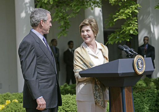 "Laura Bush looks over to President Bush during a Rose Garden announcement honoring the 2005 Preserve America Presidential Awards Winners Monday, May 2, 2005. ""These awards recognize collaborative efforts to protect and enhance our nation's cultural and historical heritage,"" said Mrs. Bush in her remarks.White House photo by Eric Draper"