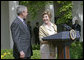 "Laura Bush looks over to President Bush during a Rose Garden announcement honoring the 2005 Preserve America Presidential Awards Winners Monday, May 2, 2005. ""These awards recognize collaborative efforts to protect and enhance our nation's cultural and historical heritage,"" said Mrs. Bush in her remarks. White House photo by Eric Draper"