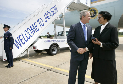 President George W. Bush meets Freedom Corps Greeter Ruth Wilson at Mississippi Air National Guard Base, Tuesday, May 3, 2005. Wilson developed a leadership training program at Mount Wade Missionary Baptist Church in Terry, Mississippi, to identify and meet needs within the community. White House photo by Eric Draper