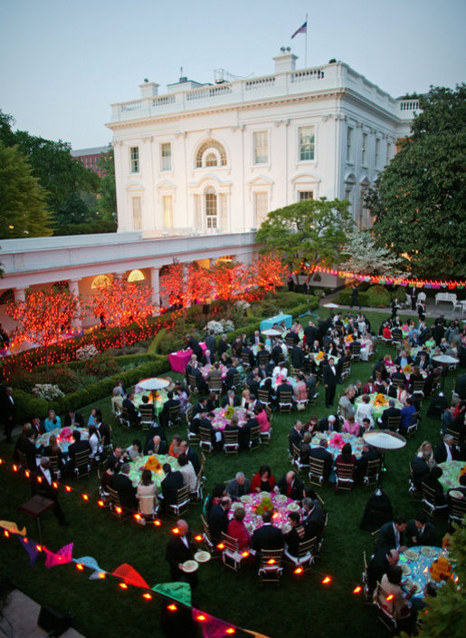 President George W. Bush and Laura Bush host a dinner celebrating Cinco de Mayo in the Rose Garden Wednesday, May 4, 2005.White House photo by Paul Morse