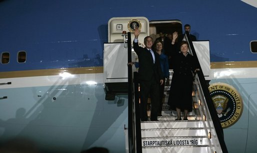 Waving to the crowd, President and Mrs. Bush and Latvia's President Vaira Vike-Freiberga deplane Air Force One Friday night, May 6, 2005, after the Bushes arrived in Riga, Latvia for the first of four European stops. White House photo by Eric Draper
