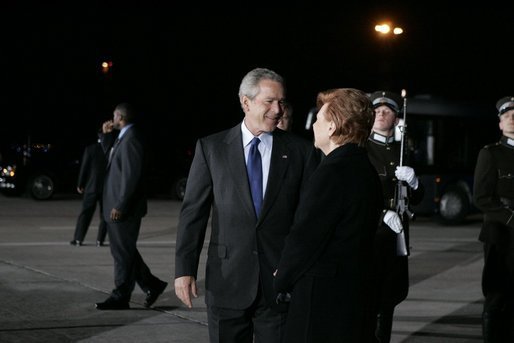 President George W. Bush and Latvia's President Vaira Vike-Freiberga pause for a moment at Riga International Airport after the President and Mrs. Bush arrived on the first stop of their four-day, four-country visit to Europe. White House photo by Krisanne Johnson