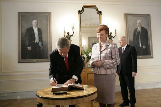 President George W. Bush and Laura Bush and Latvia President Vaira Vike-Freiberga and husband Imants Freiberg stand for the playing of the American national anthem Saturday, May 7, 2005, at the Freedom Monument in Riga, Latvia. White House photo by Eric Draper