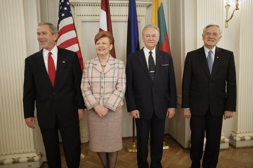 President George W. Bush stands with Latvia's President Vaira Vike-Freiberga, Estonia President Arnold Ruutel and Lithuania President Valdas Adamkus for a photo Saturday, May 7, 2005, in Riga, Latvia. White House photo by Eric Draper