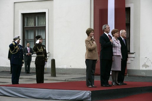 President George W. Bush and Laura Bush and Latvia President Vaira Vike-Freiberga and husband Imants Freibergs stand for the playing of the American national anthem Saturday, May 7, 2005, at Riga Castle in Riga, Latvia. White House photo by Eric Draper