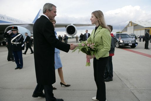 President George W. Bush and Laura Bush are presented with tulips upon their arrival in Maastricht, Netherlands, May 7, 2005. White House photo by Eric Draper