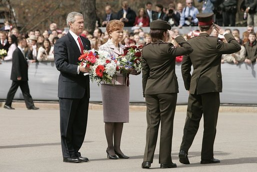 President George W. Bush and Latvia's President Vaira Vike-Freiberga participate in a wreath-laying ceremony in front of the Freedom Monument in Riga, May 7, 2005. White House photo by Paul Morse