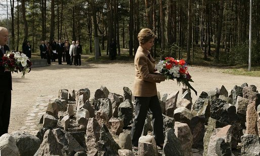 Laura Bush lays flowers at the Rumbula Holocaust Memorial in Riga, Latvia, Saturday, May 7, 2005. White House photo by Eric Draper