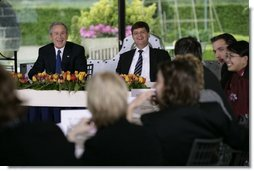 President George W. Bush and Prime Minister Jan Peter Balkenende of The Netherlands, smile as they answer questions during a youth roundtable Sunday, May 8, 2005, in Valkenburg, Netherlands.  White House photo by Eric Draper