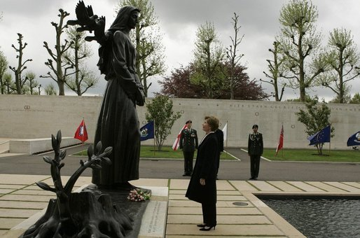 First Lady Laura Bush reflects after placing flowers at the Mourning Woman Statue in Netherlands American Cemetery Sunday, May 8, 2005, in Margraten. White House photo by Krisanne Johnson