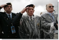 Veterans of World War II salute President George W. Bush Sunday, May 8, 2005, during a celebration at the Netherlands American Cemetery in Margraten, Netherlands, honoring those who served 60 years ago.  White House photo by Krisanne Johnson