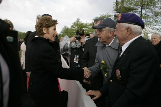 First Lady Laura Bush shakes hands with a veteran following a ceremony Sunday, May 8, 2005, in Margraten, Netherlands honoring those who served in World War II. The ceremony highlighted the President and First Lady's visit to the Netherlands before moving on to Moscow. White House photo by Krisanne Johnson