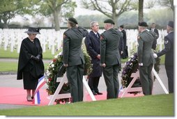 Queen Beatrix of The Netherlands and President George W. Bush pause in respect before wreaths at the Netherlands American Cemetery Sunday, May 8, 2005, in Margraten, honoring those who served during World War II.  White House photo by Eric Draper
