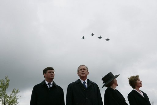 Jan Peter Balkenende, Prime Minister of The Netherlands, left, President George W. Bush, Queen Beatrix of The Netherlands, and Mrs. Laura Bush stand on stage Sunday, May 8, 2005, at the Netherlands American Cemetery in Margraten, as a flyover marks the remembrance of those who served in World War II. White House photo by Eric Draper