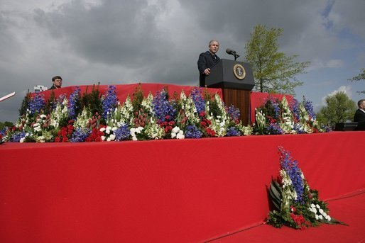 President George W. Bush addresses attendees Sunday, May 8, 2005, at Netherlands American Cemetery in Margraten, during a celebration in remembrance of those who served in World War II. White House photo by Eric Draper