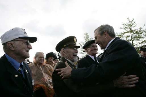 President George W. Bush greets veterans at the Netherlands American Cemetery in Margraten Sunday, May 8, 2005, following a ceremony honoring those who served in World War II. White House photo by Eric Draper