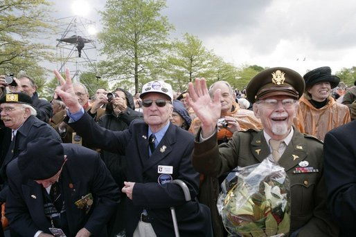 World War II veterans acknowledge President and Mrs. Bush Sunday, May 8, 2005, during a celebration at the Netherlands American Cemetery in Margraten, in remembrance of those who served during World War II. White House photo by Eric Draper