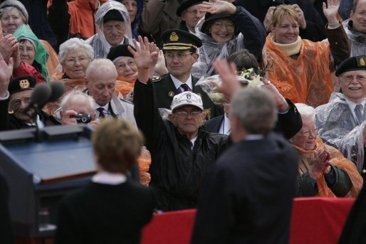 President George W. Bush and Mrs. Bush wave to a crowd at the American Cemetery in Margraten, Netherlands Sunday, May 8, 2005, honoring those who served in World War II 60 years ago. White House photo by Paul Morse