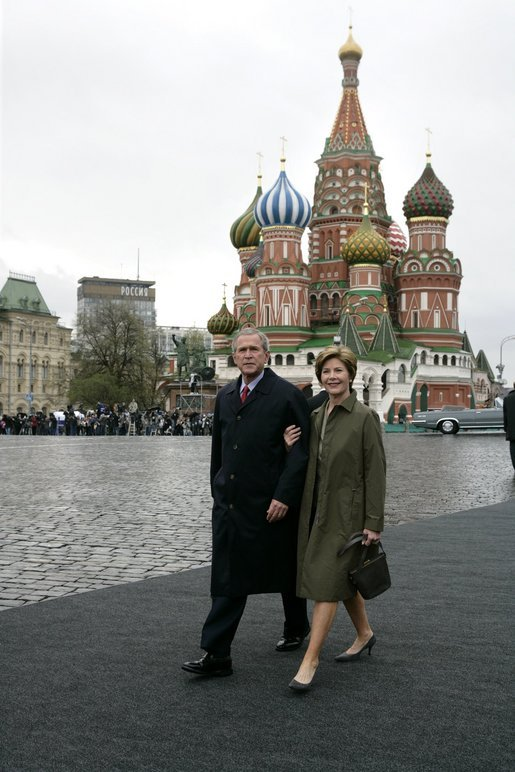 President George W. Bush and Laura Bush enter Moscow's Red Square before the start of a military parade honoring the 60th anniversary of the end of World War II Monday, May 9, 2005. White House photo by Eric Draper