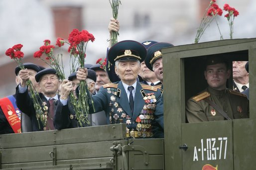 Veterans of Russia's military hold up flowers as they ride through Moscow's Red Square in a parade held to commemorate the 60th Anniversary of the end of World War II Monday, May 9, 2005. White House photo by Eric Draper