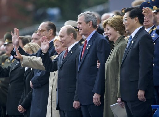 President George W. Bush and Laura Bush stand with Russian President Vladimir Putin and Lyudmila Putina, French President Jacque Chirac, far left, and Chinese President Hu Jintao, right, as many heads of state watch a parade in Moscow's Red Square commemorating the end of World War II Monday, May 9, 2005. White House photo by Eric Draper