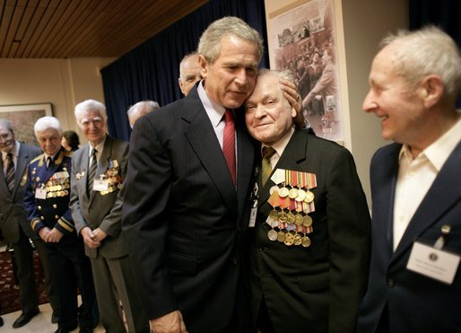 During a meeting with U.S. and Russian veterans, President George W. Bush hugs Russian veteran Vasik Ivanovich Korneer after he offered the President a coin from his service in Berlin during World War II in Moscow, Monday, May 9, 2005. President Bush asked that the veteran give the coin to a family member and thanked him for his courage. White House photo by Eric Draper