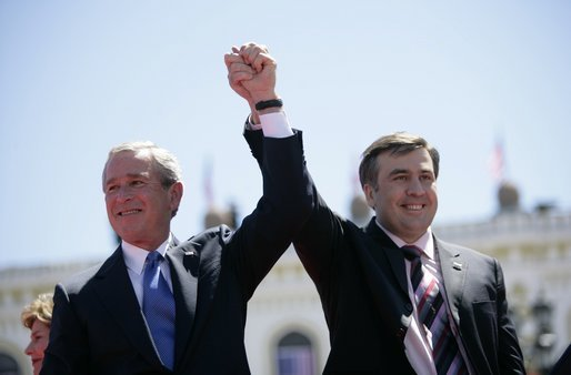 "President George W. Bush and President Mikhail Saakashvili of Georgia react to the cheering of thousands of Tbilisi citizens in Freedom Square Tuesday, May 10, 2005. ""You are building a democratic society where the rights of minorities are respected, where a free press flourishes, a vigorous opposition is welcome, and unity is achieved through peace,"" said the President in his remarks. ""In this new Georgia, the rule of law will prevail, and freedom will be the birthright of every citizen."" White House photo by Eric Draper"