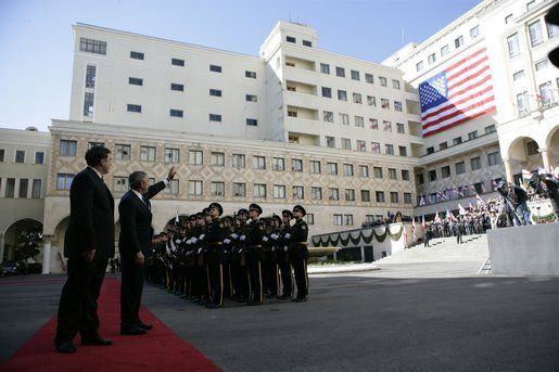 President George W. Bush waves to the crowd as he and Georgian President Mikhail Saakashvili review military troops during President Bush's visit to the Georgian Parliament in Tbilisi Tuesday, May 10, 2005. White House photo by Eric Draper