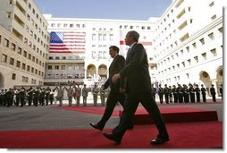 President George W. Bush walks with President Mikhail Saakashvili during an arrival ceremony in the courtyard of the Parliament Building in Tbilisi, Georgia, Tuesday, May 10, 2005.  White House photo by Paul Morse