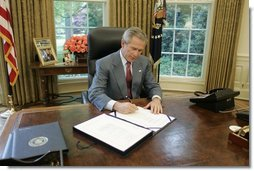 "President George W. Bush signs into law H.R. 1268, the ""Emergency Supplemental Appropriations Act for Defense, the Global War on Terror, and Tsunami Relief, 2005,"" Wednesday, May 11, 2005, in the Oval Office. The bill provides emergency supplemental appropriations for military operations, relief and reconstruction, and related activities critical to building stable democracies in Iraq and Afghanistan, as well as assisting those who suffered in the aftermath of the December 2004 tsunami in the Indian Ocean.  White House photo by Paul Morse"