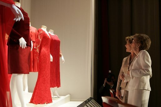 Laura Bush and Nancy Reagan view part of The Heart Truth's First Ladies Red Dress Collection on exhibit Thursday, May 12, 2005, at the John F. Kennedy Center for the Performing Arts in Washington D.C. White House photo by Krisanne Johnson